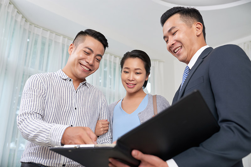 real estate agent showing docs to clients